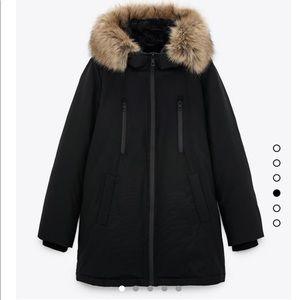 Black parka winter jacket with faux fur hood trim